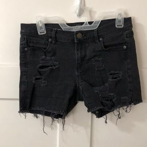 Size 27 black distressed shorts.